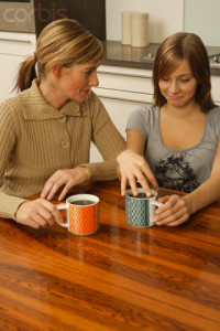 Mom Having Heart to Heart Talk with Embarrassed Daughter